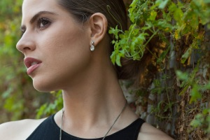 Side profile of girl with diamond earring and vines wearing MODELLAUNCHER make-up.