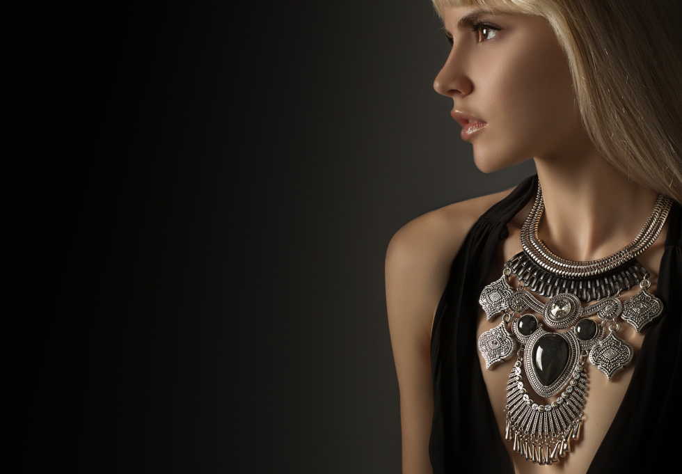 Blonde model side profile with focus on jewelry.